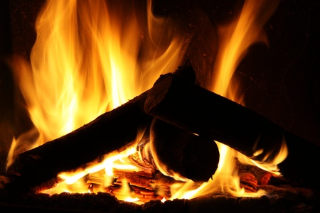 Fire in a fireplace, fire flames on a black background photo