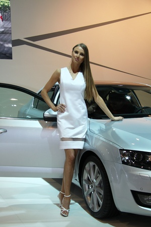 BRNO, CZECH REPUBLIC - APRIL 4: Hostess with Skoda Octavia 3rd Generation on display at the 11th edition of International Autosalon Brno on April 4, 2013 in Brno, Czech Republic.
