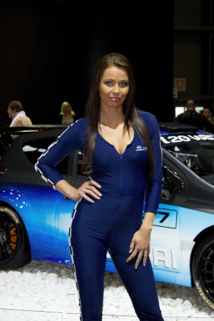 BRNO, CZECH REPUBLIC - APRIL 4: Hostess with Hyundai i20 WRC on display at the 11th edition of International Autosalon Brno on April 4; 2013 in Brno, Czech Republic.