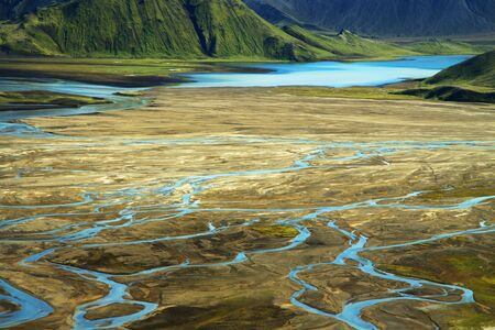 Wild river delta with mountains, Iceland Imagens