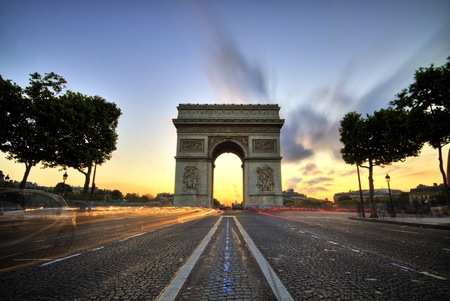 Arc de Triomphe: Arc de Triomphe at sunset, Paris  Stock Photo