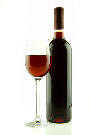 Bottle and glass of red wine isolated Stock Photo