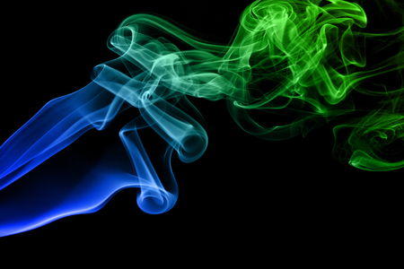 Colored smoke isolated on black background Stock Photo