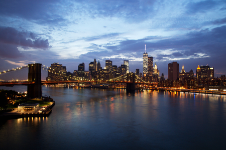 wtc: New York City Manhattan Downtown with Brooklyn Bridge at dusk Stock Photo