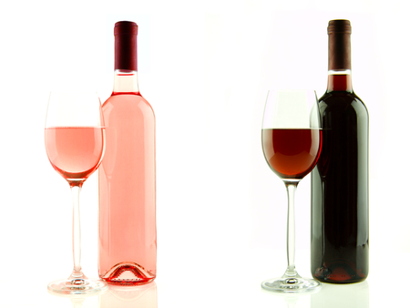 Bottle and glass of pink and red wine isolated