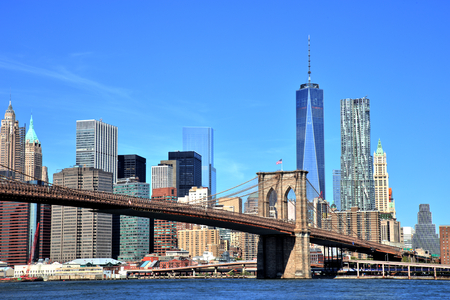 View of New York City Downtown Skyline with Brooklyn Bridge Stock Photo