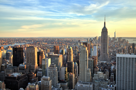 new york city panorama: New York City Midtown with Empire State Building at Sunset Stock Photo
