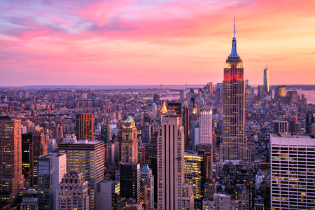 cities: New York City Midtown with Empire State Building at Amazing Sunset Stock Photo
