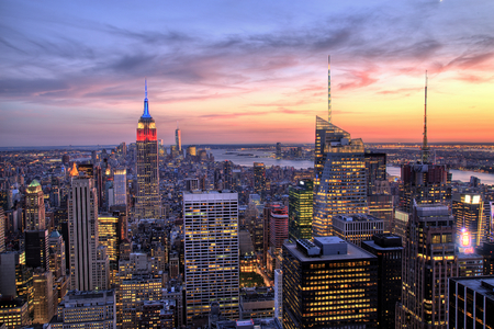 new york city panorama: New York City Midtown with Empire State Building at Dusk Stock Photo
