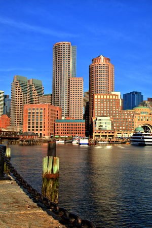 financial district: Boston Skyline with Financial District and Boston Harbor at Sunrise Editorial