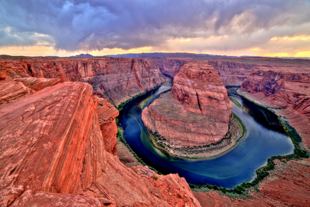 Horseshoe Bend on Colorado River at Sunset and Cloudy Weather, Utah Stock Photo