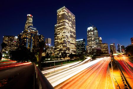 City of Los Angeles Downtown at Sunset With Light Trails Stock Photo