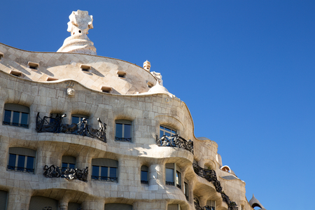 BARCELONA, SPAIN - JULY 4: Casa Mila at night on July 4, 2017 in Barcelona. The Casa Mila is also part of the Antoni Gaudi listed under UNESCO World Heritage Sites.