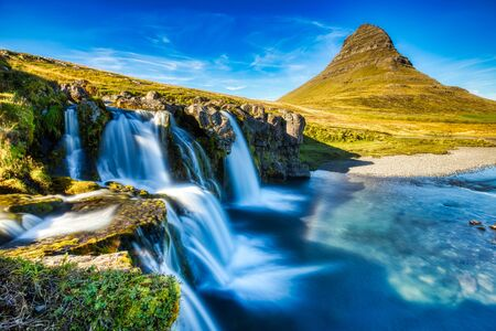 Iceland Landscape Summer Panorama, Kirkjufell Mountain during a Sunny Day with Waterfall in Beautiful Light