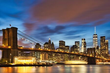 New York City Manhattan downtown with Brooklyn Bridge at Dusk, USA