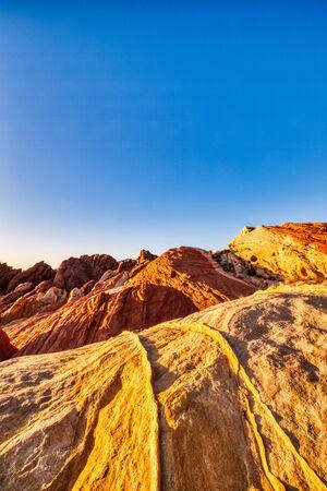 Valley of Fire State Park Landscape near Las Vegas, Nevada, USA Keywods: valley, fire, landscape, landmark, sunrise, sunset, desert, narrows, valley of fire state park, sandstone, nevada, nature, valley of fire, geology, scenic, red, park, orange, dry, rock, formation, tourism, stone, erosion, sky, wave, stripe, blue, vibrant, scenery, vegas, red rock, sunlight, sand, usa, america, stripes, state, mountain, beautiful, colorful, natural, canyon, southwest, evening, shape, summer, wilderness, las vegas