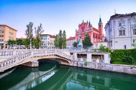 Ljubljana City Center at Dusk overlooking the Triple Bridge and Beautiful Franciscan Church, Slovenia
