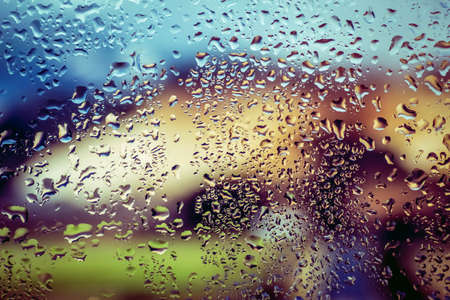 a lot of colorfull drops on window
