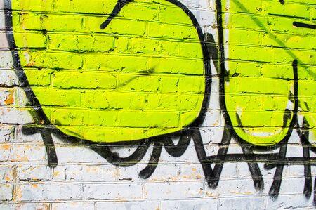 Brick wall with bright graffiti Stock Photo