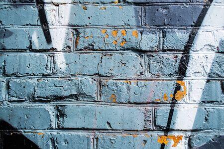 graffity: Brick wall with bright graffity Stock Photo
