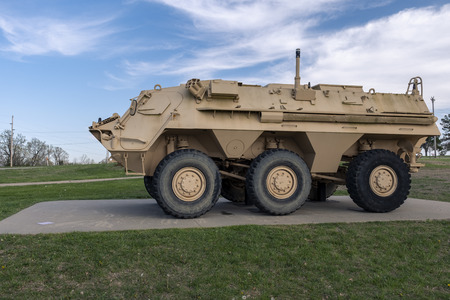 Military Vehicle M93A1 FOX NBCRS Nuclear, Biological, Chemical, Reconnaissance is amphibious and fully automated system to detect hazards from the interior of the vehicle. An outdoor military vehicle complex featuring vehicles used throughout military his