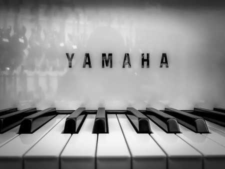 Kyiv, Ukraine - 16 jun 2020: Black and white photo from the exhibition of new musical instruments from Yamaha. Yamaha piano keyboard with logo on the front panel. Editorial