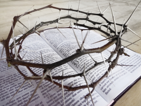 isaiah: thorn crown of Jesus sitting on the famous passage of the Bible, Isaiah 53