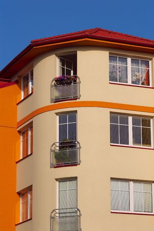Photo of an apartment house in bright solar morning