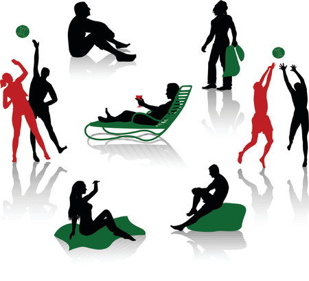 beach game: Silhouettes of people having a holiday on the beach