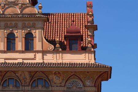 pediment: Photo of a part of an old building with stucco mouldings on a pediment.