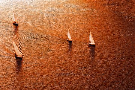 yacht race: Regata de vela en tonos c�lidos. La vista superior