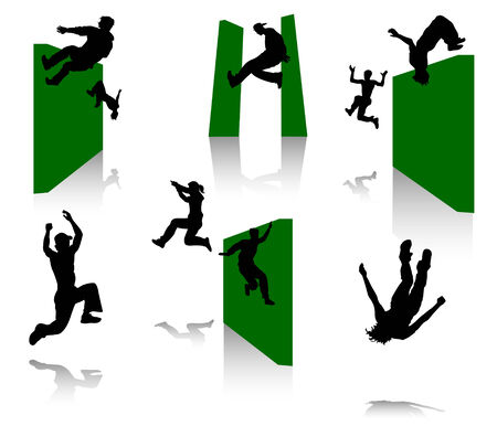 Silhouettes of young men in movement. Parkour.