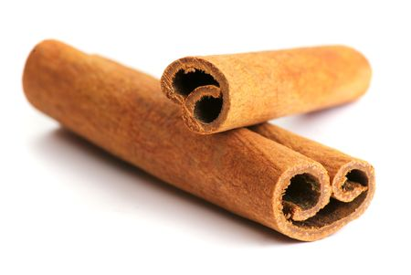 Two cinnamon sticks isolated on white background. Close up. Stock Photo