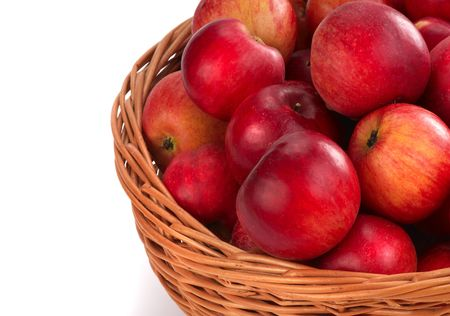 Harvesting. A basket with red ripe apples. photo
