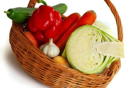 Autumn abundance, harvesting. A basket with vegetables.  photo
