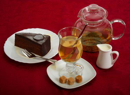 Still life. Ginger tea, chocolate cake and cane sugar. photo
