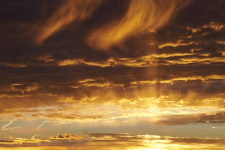 distant: Sunset evening sky  Sun in the clouds Stock Photo