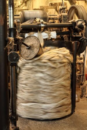 An image of henequen fiber that is processed by high speed machinery to form natural fiber cord, color, ambient light strands. Yucatan. Mexio Stock Photo