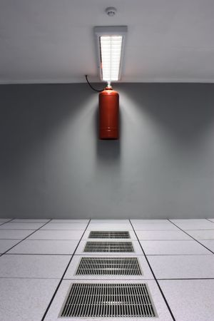 A dreamy shot of a serverdata center with airconditioner grids and a fire suppression system including FM200 safe gas bottle and a smoke detector. photo