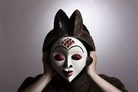 Woman with African mask photo