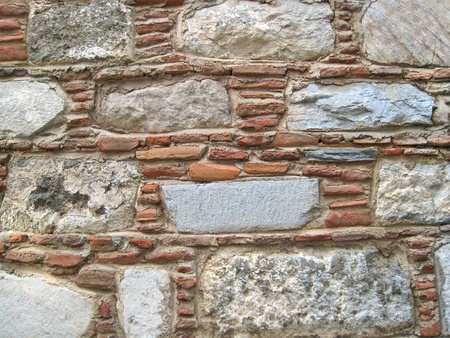 Real wall made of stones and brick