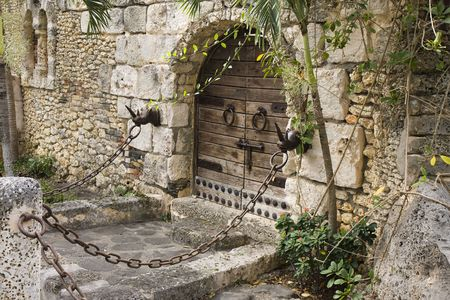 castle interior: Old castle gate. Medieval chains. Stone wall.