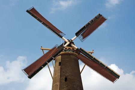 Dutch windmill in Schiedam, The Netherlands. Blue sky background. photo