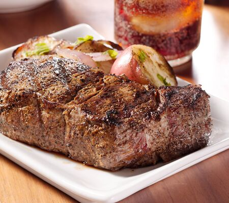 grilled new york strip steak with potatoes.