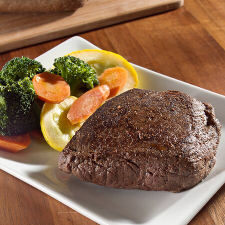 seared steak with vegetables photo