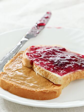 Peanut butter and jelly on pieces of bread. photo