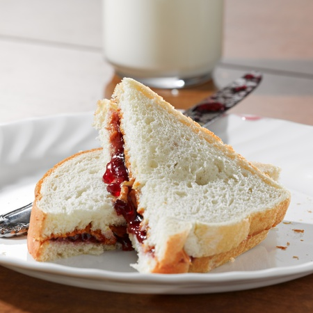jam sandwich: Peanut butter and jelly sandwhich Stock Photo