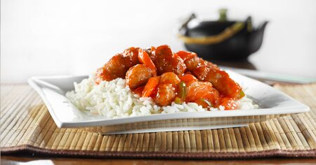 sweet and sour pork on rice wide shot photo