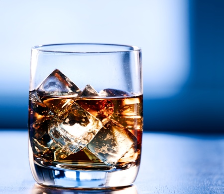 alcoholic drink: Highball glass of alcohol with ice