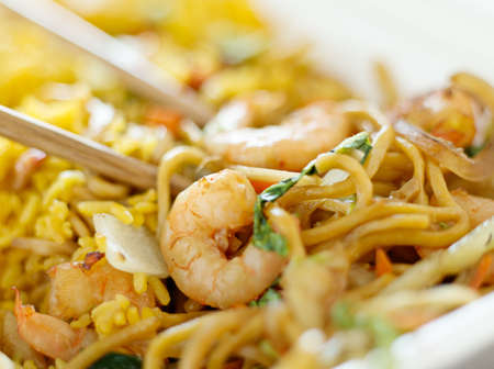 shrimp lo mein with fried rice with extremly thin focus and blurry background. photo